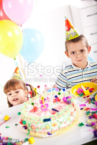 502282224 istock photo Kids having fun while celebrating birthday 465374924