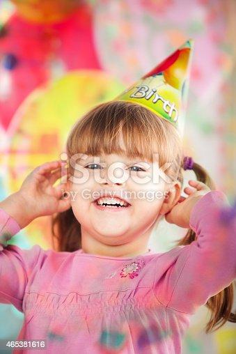 502282224 istock photo Kids having fun while celebrating birthday 465381616