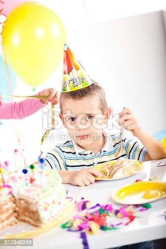 502282224 istock photo Kids having fun while celebrating birthday 517346249