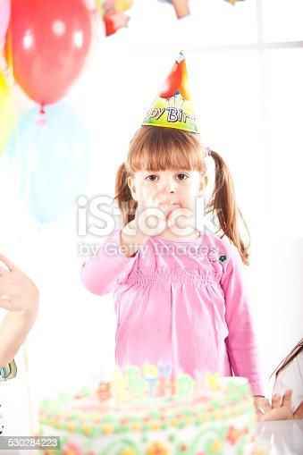 502282224 istock photo Kids having fun while celebrating birthday 530284223