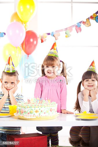 502282224 istock photo Kids having fun while celebrating birthday 530284227
