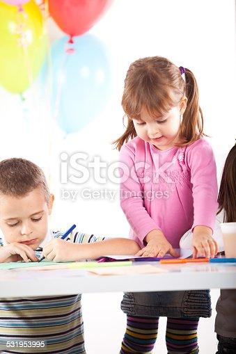 502282224 istock photo Kids having fun while celebrating birthday 531953995