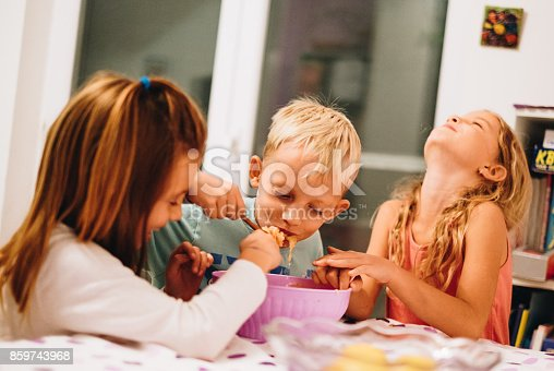505657693 istock photo Kids having fun while share their meal 859743968