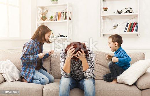 istock Kids having quarrel over tired mother 918516940