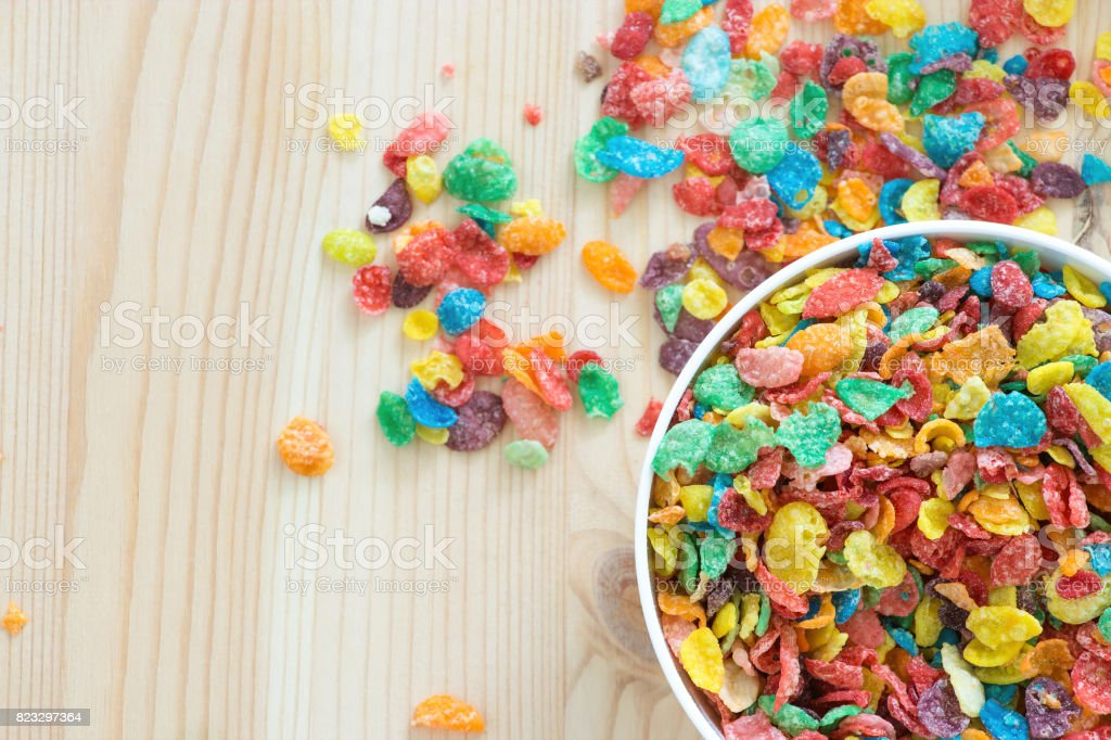 Kids healthy quick breakfast. Colorful rice cereal on wooden background. Copy space stock photo