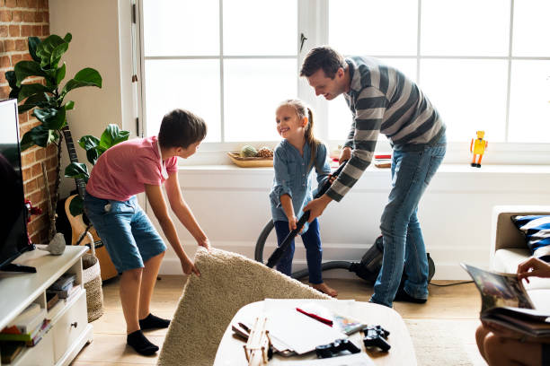 kids helping house chores - household chores stock photos and pictures