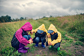 Kids hikers observing a snail