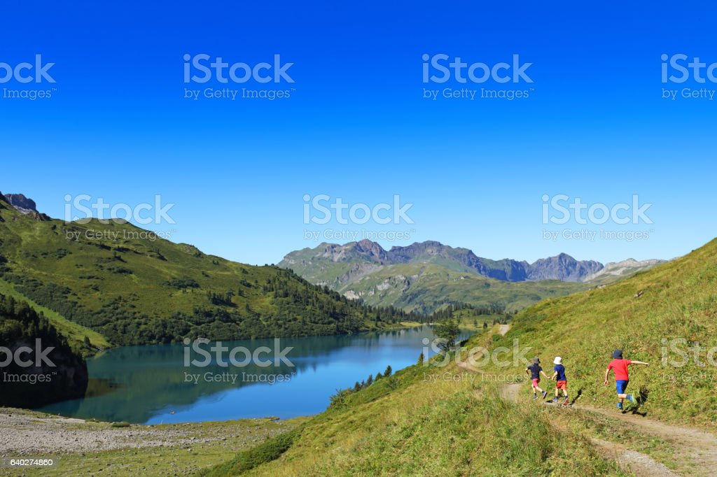 Kids Hiking in the Mountains stock photo