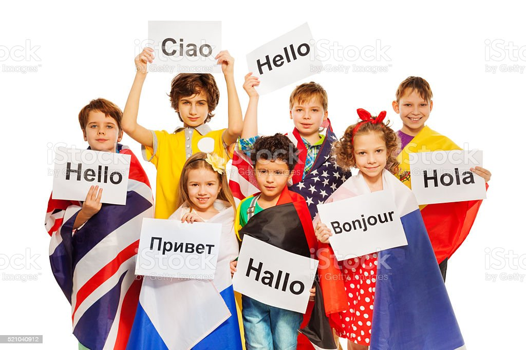 Kids holding greeting signs in different languages stock photo