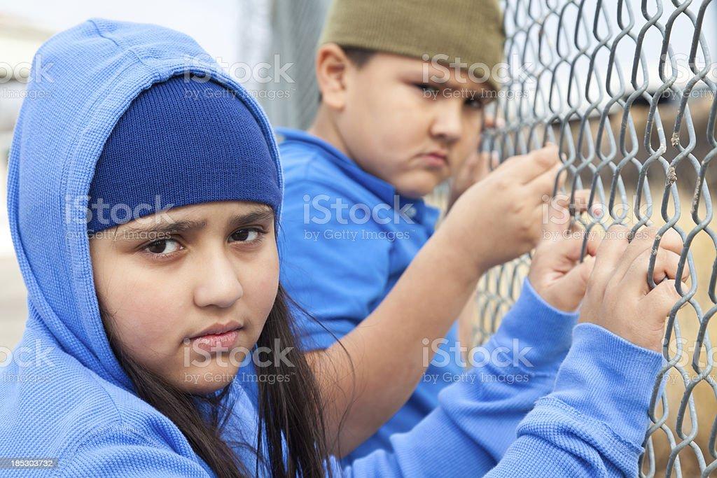 Kids holding onto fence royalty-free stock photo
