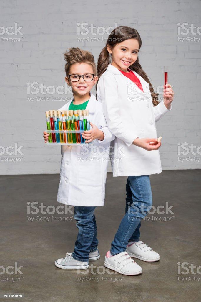 Kids holding test tubes royaltyfri bildbanksbilder