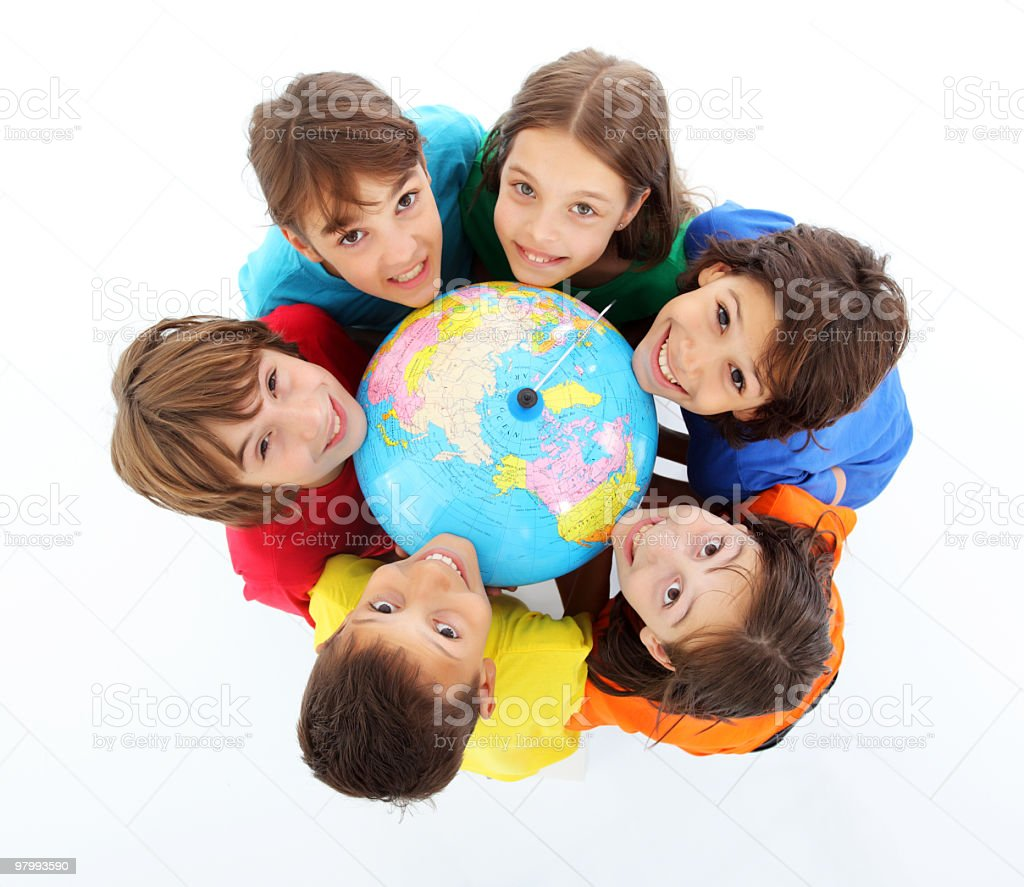 Kids holding together a terrestrial globe. royalty-free stock photo
