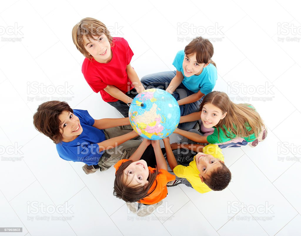 Kids holding together a terrestrial globe. royalty free stockfoto