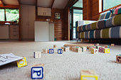 Toys scattered in living room.