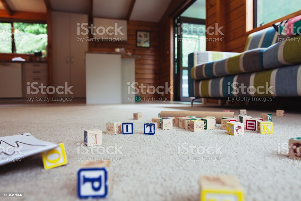 Kids house with toys on carpet. stock photo