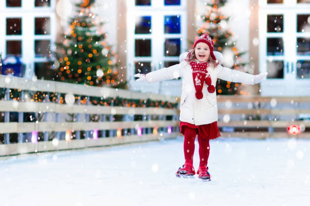 Kids ice skating in winter. Ice skates for child. Kids ice skating in winter park rink. Children ice skate on Christmas fair. Little girl with skates on cold snowy day. Snow outdoor fun for child. Winter sports. Xmas vacation activity with kid. ice skating stock pictures, royalty-free photos & images