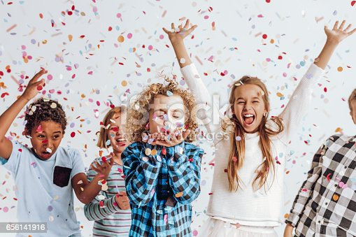 istock Kids in a room full of confetti 656141916
