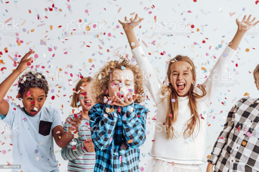 Kids in a room full of confetti stock photo
