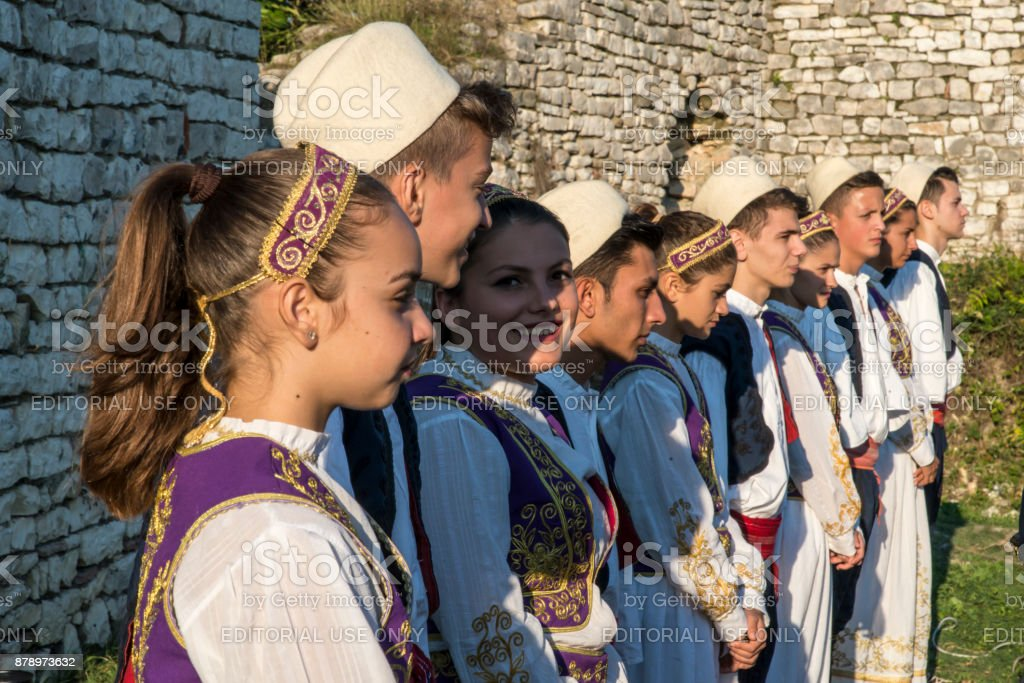 Kids in a traditional costume in a music festival in Berat castle, Albania stock photo