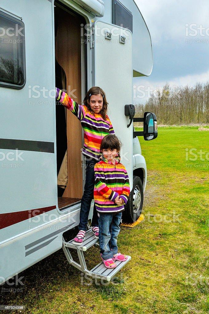 Kids in camper (rv), family travel in motorhome stock photo
