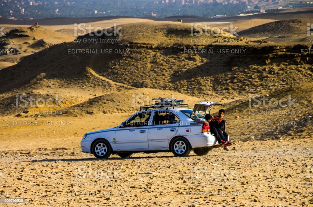 Kids in car in the Pyramids of Giza. Cairo, Egypt. stock photo