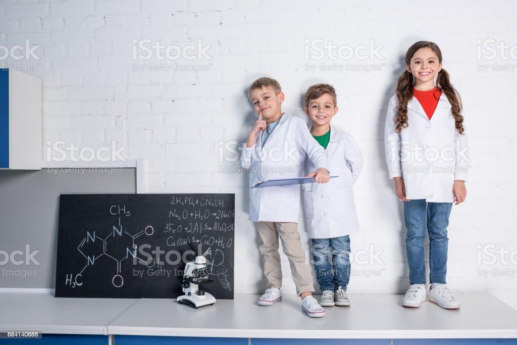 Kids in chemical laboratory zbiór zdjęć royalty-free