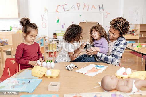 istock Kids in daycare learning about domestic animal 887557840