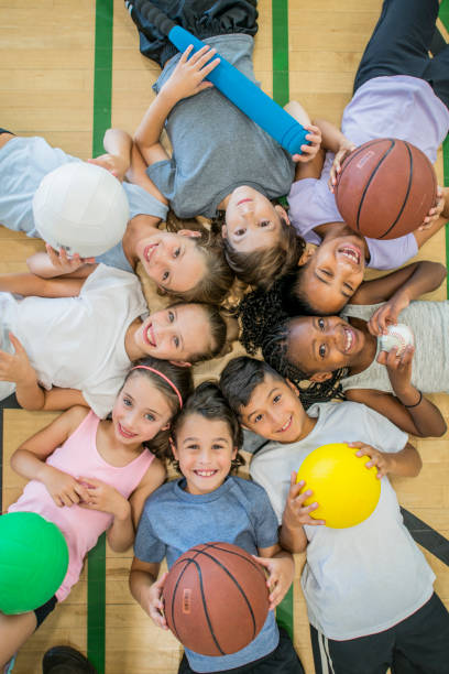 kids in gym - volleyball sport stock photos and pictures