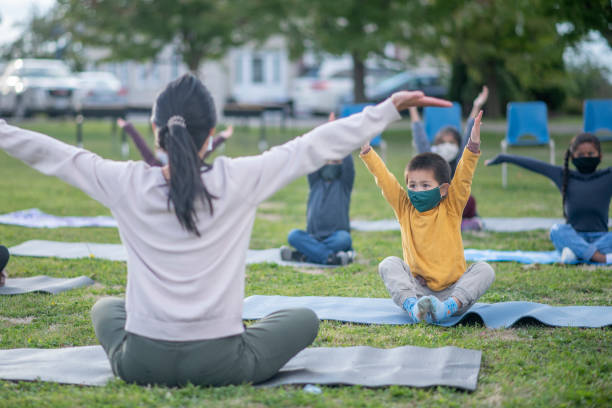 Kids in outdoor fitness class at school stock photo