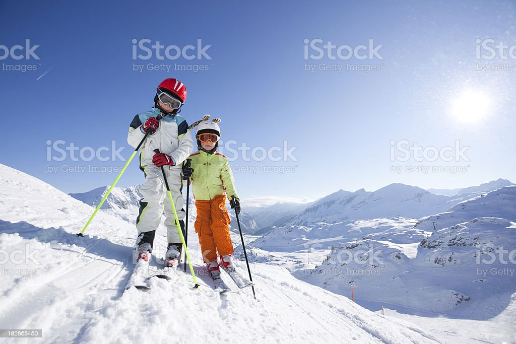 kids in skiing outfit on slope royalty-free stock photo