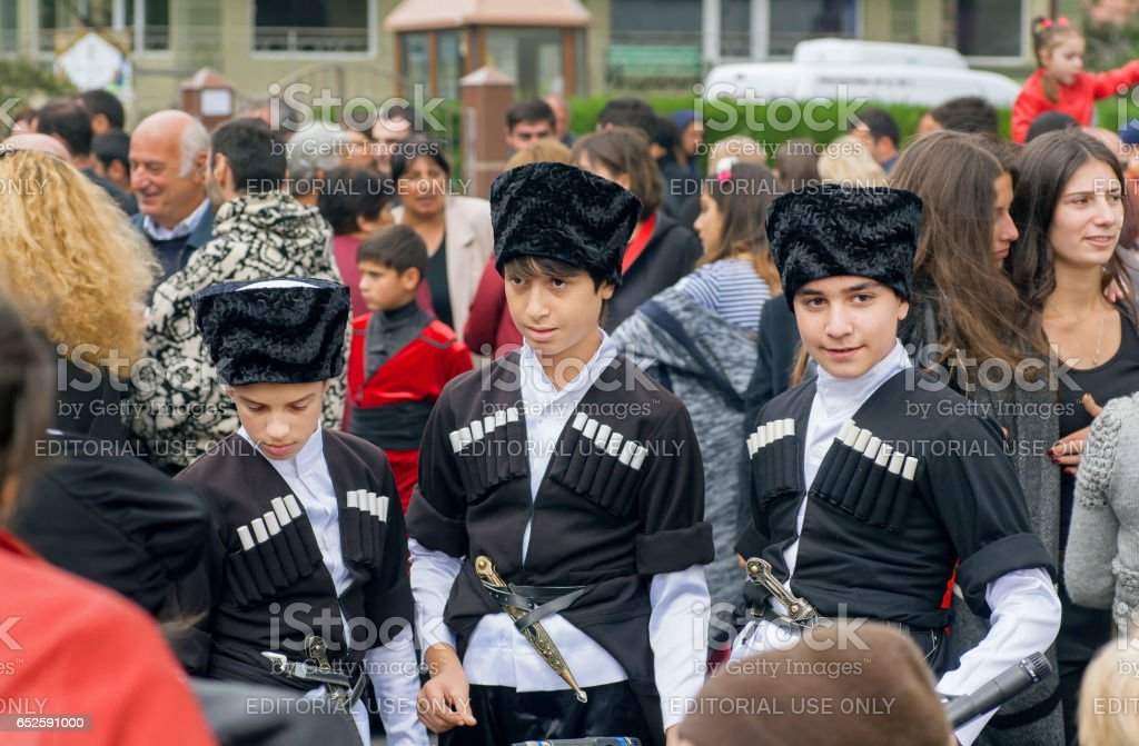 Kids In Traditional Georgian Costumes Going To Crowd Of People Stock Photo  - Download Image Now