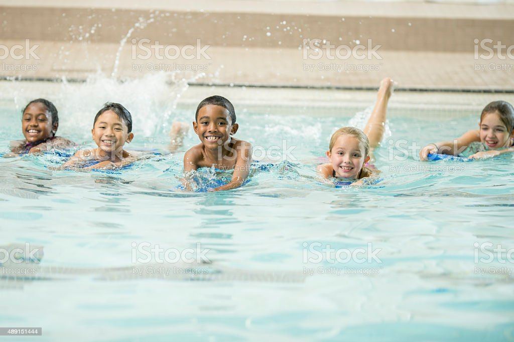 Kids Kicking in the Water stock photo