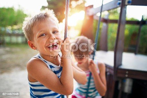 istock Kids laughing at the playground 621462548