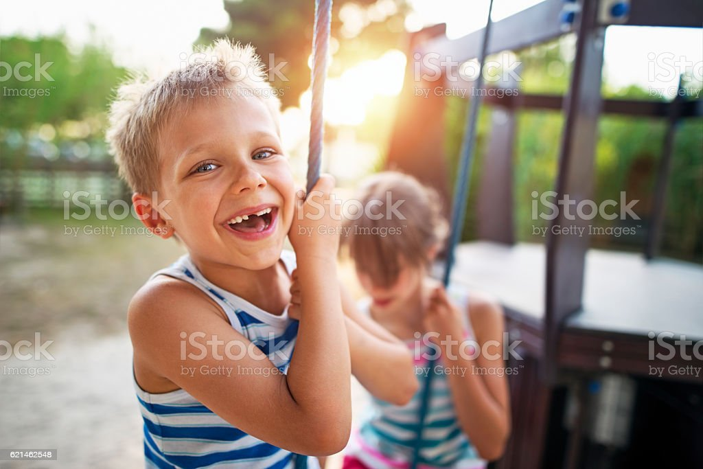 Kids laughing at the playground stock photo