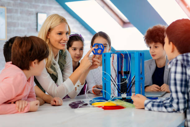 Kids Learning 3D Printing In School stock photo