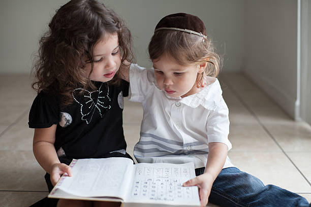 Kids learning Aleph Bet Brother and sister studying the Aleph Bet together judaism stock pictures, royalty-free photos & images