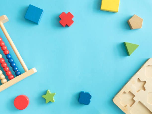 Kids learning concept with stacking toys on blue table background picture id1176297391?b=1&k=6&m=1176297391&s=612x612&w=0&h=dp7h5j5f4sms50fdngrfu2o9yp0kzpxosp5btrqnbui=
