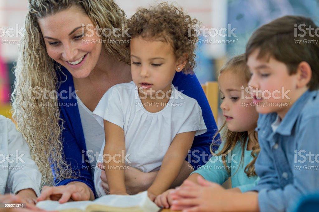 Kids learning in Sunday school stock photo