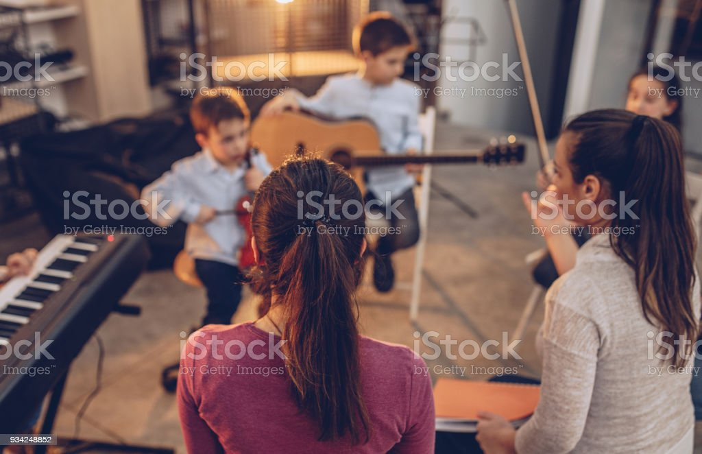 Kids learning music stock photo