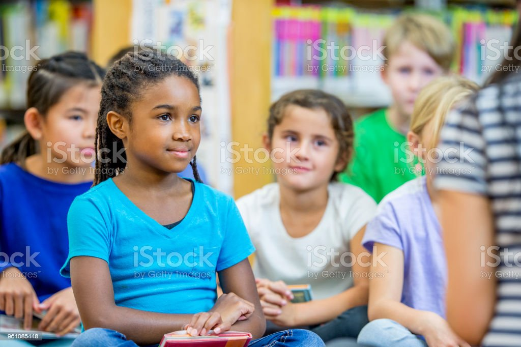 Kids Listening To A Story - Royalty-free 30-34 Years Stock Photo
