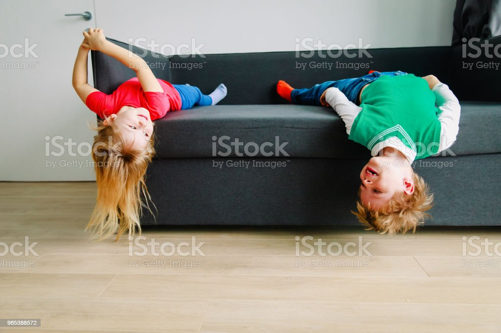 kids- little boy and girl- have fun play at home royalty-free stock photo