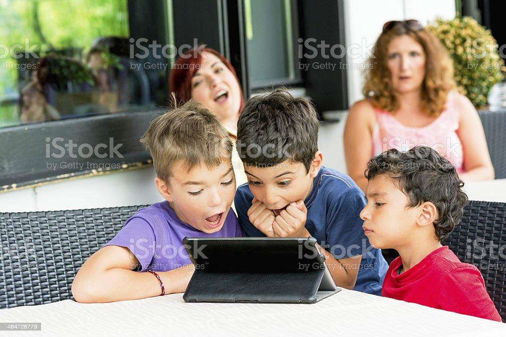 Kids looking on digital tablet royalty-free stock photo