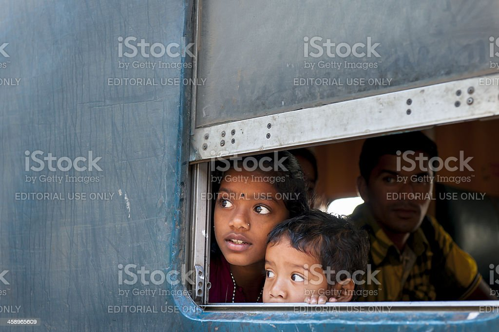Kids looking out the window of train compartment, Bangladesh royalty-free stock photo