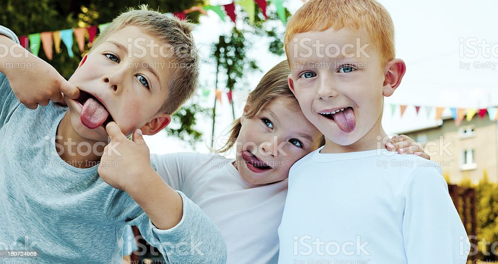 Kids Making a Face Outdoor portrait of three preschool kids making a funny faces. 4-5 Years Stock Photo