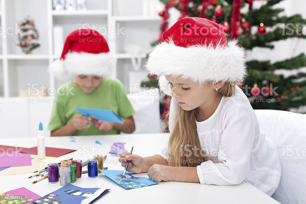 Kids making christmas greeting cards stock photo