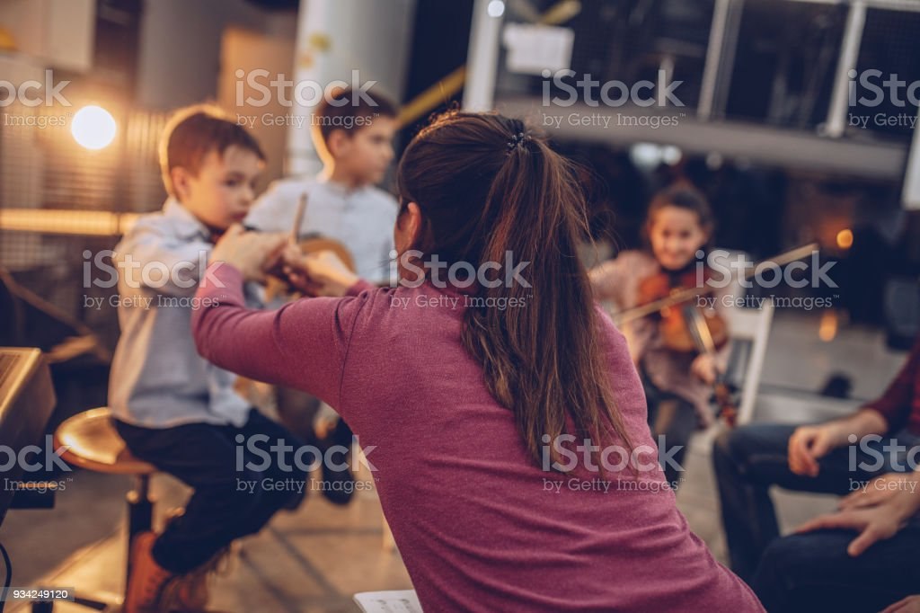 Kids making music in school stock photo