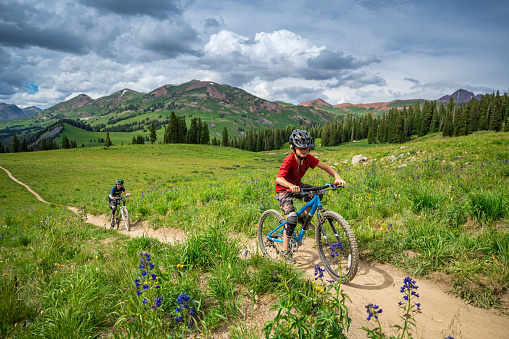 A modern family of bikers, riding on bicycles in Crested Butte, Colorado.