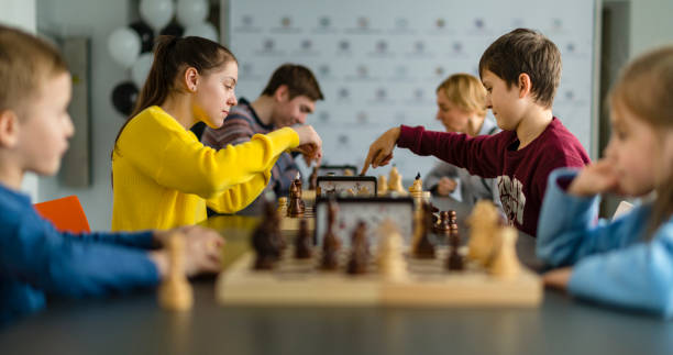 Kids of different ages boys and girls playing chess on the tournament picture id1059430592?b=1&k=6&m=1059430592&s=612x612&w=0&h=yg9bqwzpvxid4srhcpfysftwgiaewbfmpepxuryueqe=