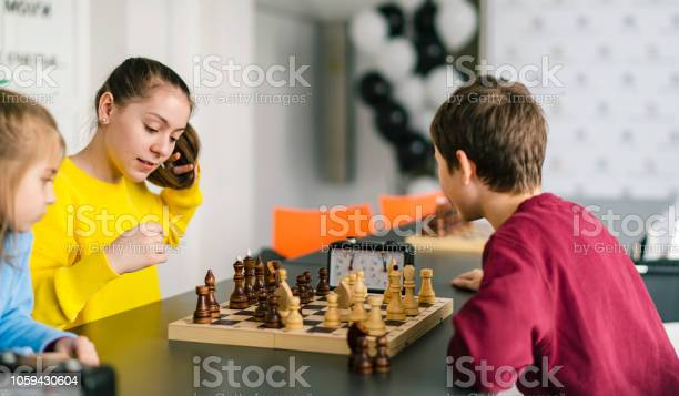 Kids of different ages boys and girls playing chess on the tournament picture id1059430604?b=1&k=6&m=1059430604&s=612x612&h=9erzfqelmxjbiivhd75sbgq t0lhh9n1low56bnhvbg=