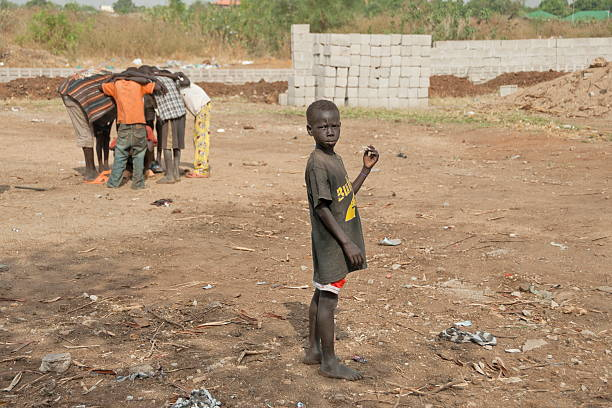 kids of refugees play on a street, juba, south sudan. - disinherit stock pictures, royalty-free photos & images